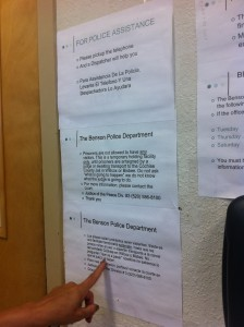 Monse reads posted signs at the Benson Police Department