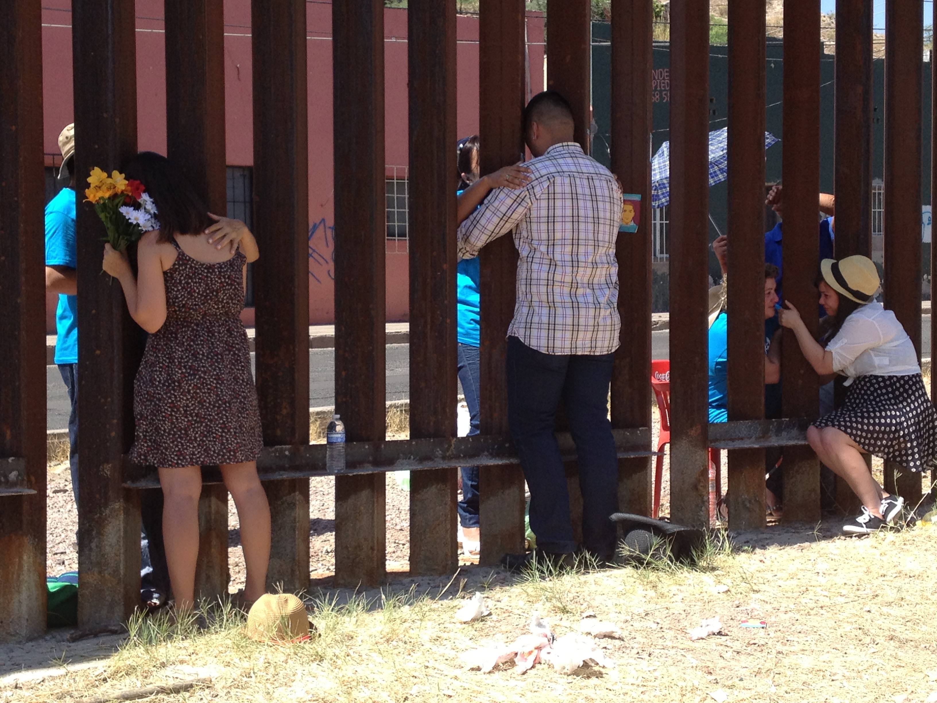 A bittersweet reunion lets three young immigrants see - and reach for - their deported mothers through a fence while organizers and reporters look on.