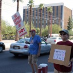 protesters from the Arizona Remember 1986 Chapter of the Rememberance Project